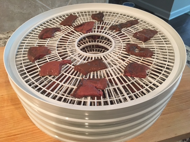 Loading the liver pieces onto the dehydrator tiers