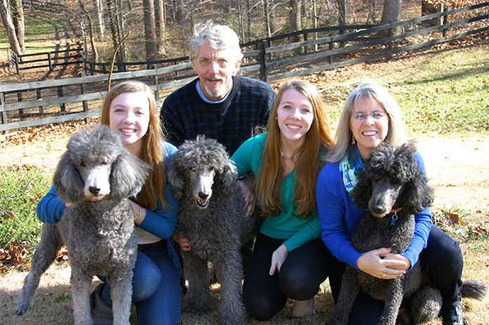 family with Silver Standard Poodles