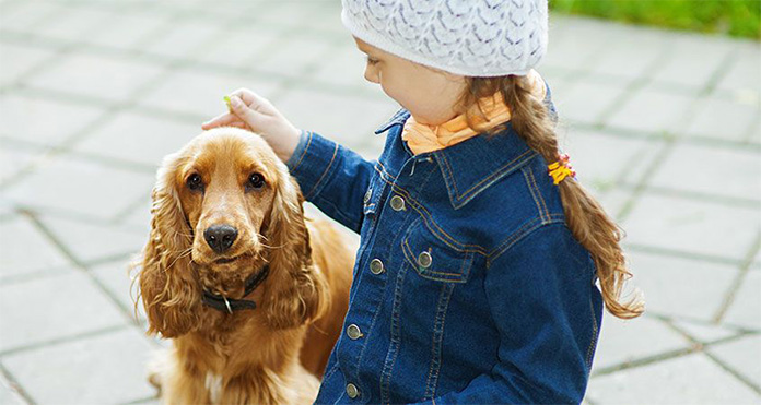 girl pet her dog