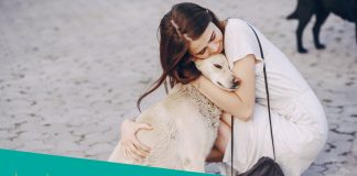 Featured image of pretty girl hugging white canine
